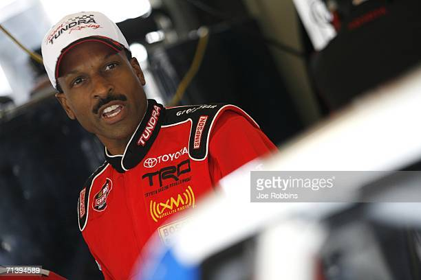 Bill Lester driver of the Rally's Toyota prepares to run laps during the NASCAR Craftsman Truck Series Built Ford Tough 225 practice on July 7 2006...