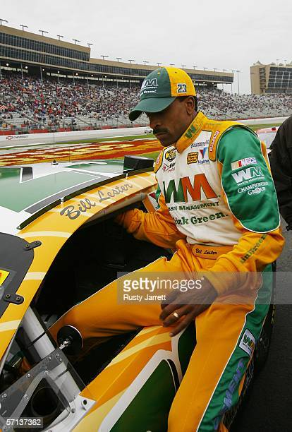 Bill Lester driver of the Waste Management Dodge gets into his car before the start of the NASCAR Nextel Cup Series Golden Corral 500 at the Atlanta...