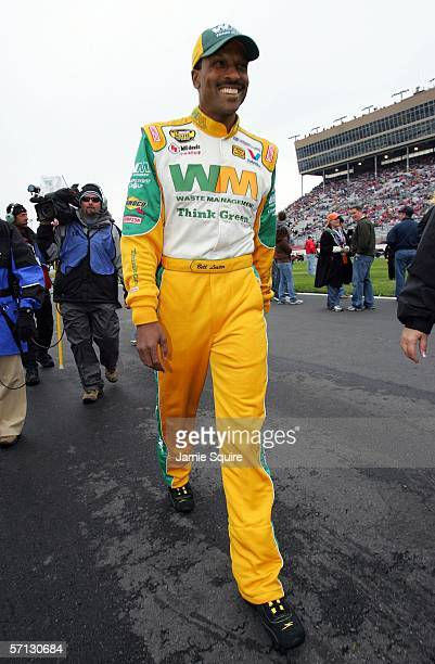 Bill Lester driver of the Waste Management Dodge walks along pit row before the start of the NASCAR Nextel Cup Series Golden Corral 500 at the...
