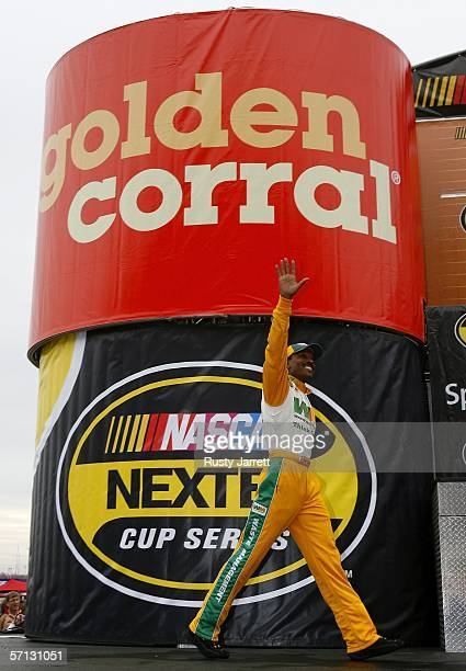 Bill Lester driver of the Waste Management Dodge waves to the crowd as he is introduced at the NASCAR Nextel Cup Series Golden Corral 500 at the...
