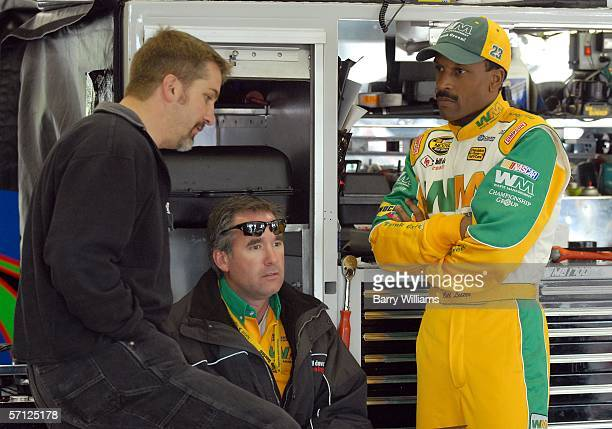 Bill Lester driver of the Waste Managment Dodge talks with members of his crew during practice for the NASCAR Nextel Cup Series Golden Corral 500 at...