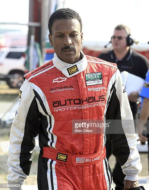 Bill Lester walks through the paddock after qualifying for the American Red Cross 250 GrandAm Rolex Series race at New Jersey Motorsports Park on...
