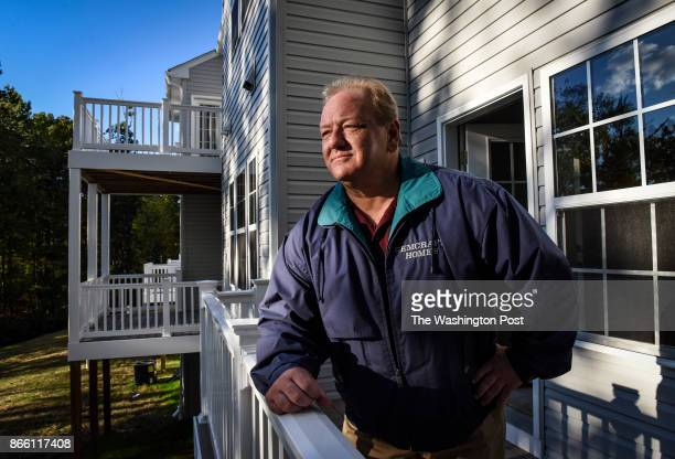 Bill Luther CEO of Gemcraft homes fighting a fair housing complaint against him on the deck of one of his unfinished houses for sale through a local...
