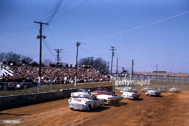 Bill Lutz driving an Oldsmobile for Petty Enterprises leads the pack during a NASCAR Convertible Series race at Greensboro Fairgrounds