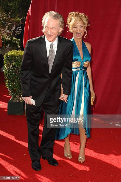 Bill Maher and Karrine Steffans during The 57th Annual Emmy Awards Arrivals at Shrine Auditorium in Los Angeles California United States