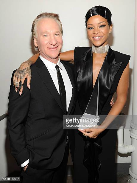 Bill Maher and Rihanna attend 2013 American Music Awards at Nokia Theatre LA Live on November 24 2013 in Los Angeles California