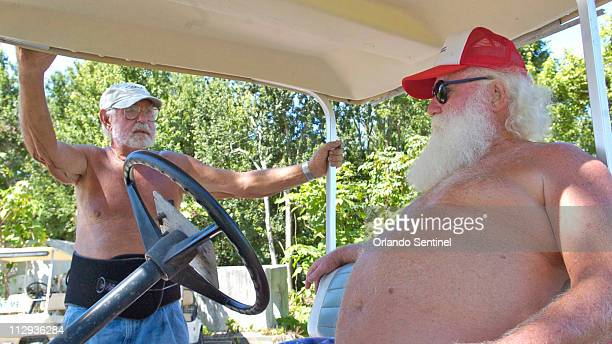 Bill Martin left talks with Lake Como Family Nudist Resort coop president Jack McElhinney June 22 at the resort in Lutz Florida Pasco County is known...