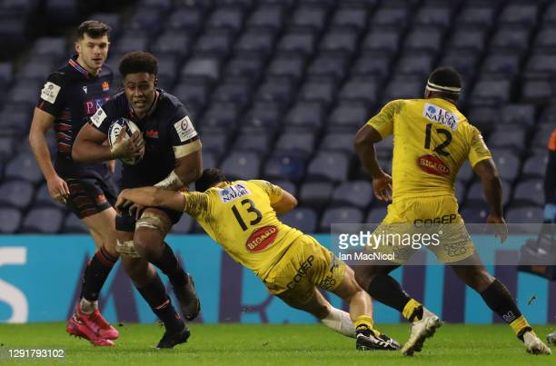 Bill Mata of Edinburgh is tackled by Geoffrey Doumayrou of La Rochelle during the Heineken Champions Cup Pool 1 match between Edinburgh Rugby and La...