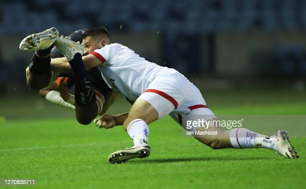Bill Mata of Edinburgh Rugby is tackled by James Hume of Ulster during the Guinness PRO14 PlayOff Semi Final between Edinburgh and Ulster at...