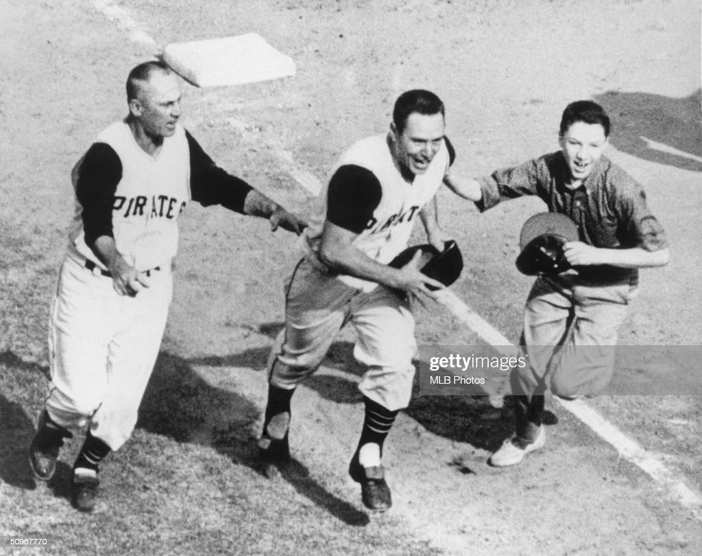 Bill Mazeroski #9 of the Pittsburgh Pirates celebrates as he runs home after hitting a walk off home run in the bottom of the ninth in Game 7 of the 1960 World Series against the New York Yankees at Forbes Field in Pittsburgh, Pennsyvania. The Pirates defeated the Yankees 10-9.
