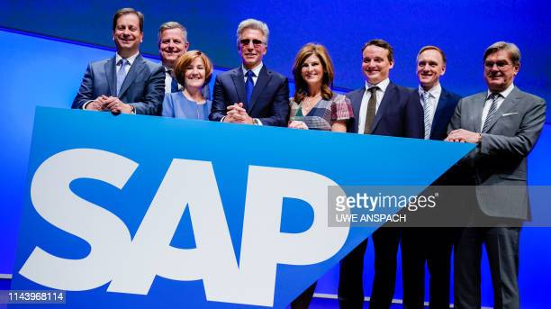 Bill McDermott CEO of German software and cloud computing giant SAP and board members pose during the company's annual general meeting on May 15 2019...
