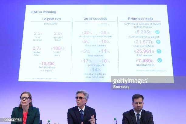 Bill McDermott, chief executive officer of SAP AG, center, speaks as he sits between Nicola Leske, chief communications officer of SAP SE, left, and...