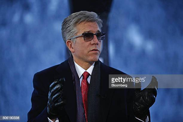 Bill McDermott chief executive officer of SAP AG gestures as he speaks during a Bloomberg Television interview during the World Economic Forum in...