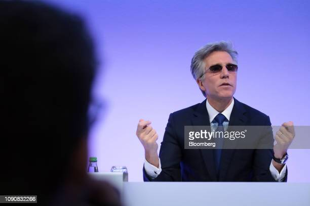 Bill McDermott, chief executive officer of SAP AG, gestures while speaking during a full year earnings news conference at the software companys...