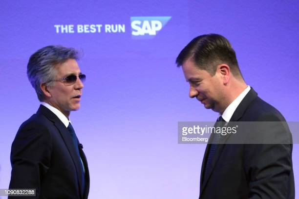 Bill McDermott, chief executive officer of SAP AG, left, and Luka Mucic, chief financial officer of SAP SE, depart following a full year earnings...