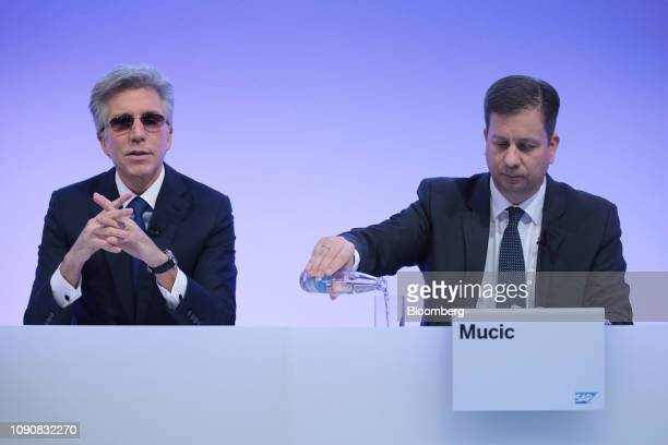 Bill McDermott, chief executive officer of SAP AG, left, speaks as he sits beside Luka Mucic, chief financial officer of SAP SE, during a full year...