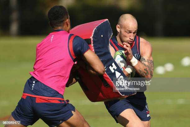 Bill Meakes is tackled during a Melbourne Rebels Super Rugby training session at AAMI Park on June 26 2018 in Melbourne Australia