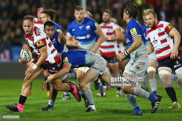Bill Meakes of Gloucester is tackled by Chris Ashton and Mako Vunipola of Saracens during the Aviva Premiership match between Gloucester and Saracens...