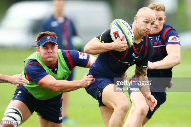 Bill Meakes of the Rebels breaks a tackle during a Melbourne Rebels Super Rugby training session at Gosch's Paddock on May 28 2018 in Melbourne...