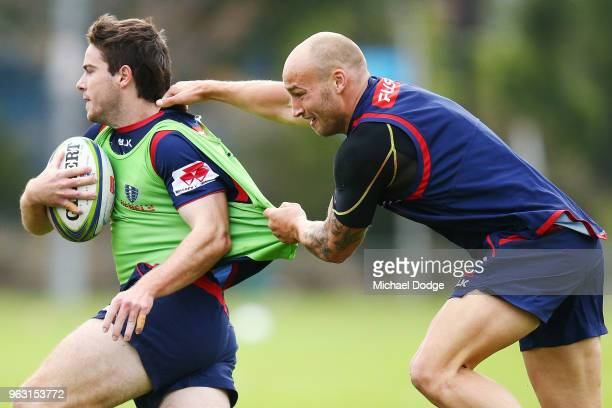 Bill Meakes of the Rebels makes a tackle during a Melbourne Rebels Super Rugby training session at Gosch's Paddock on May 28 2018 in Melbourne...