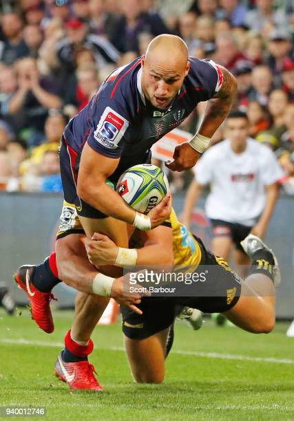 Bill Meakes of the Rebels runs with the ball during the round seven Super Rugby match between the Rebels and the Hurricanes at AAMI Park on March 30...