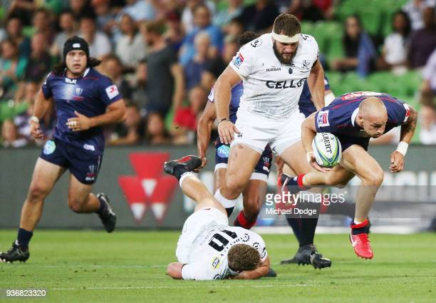Bill Meakes of the Rebels runs with the ball pass Robert du Preez of the Sharks during the round six Super Rugby match between the Melbourne Rebels...