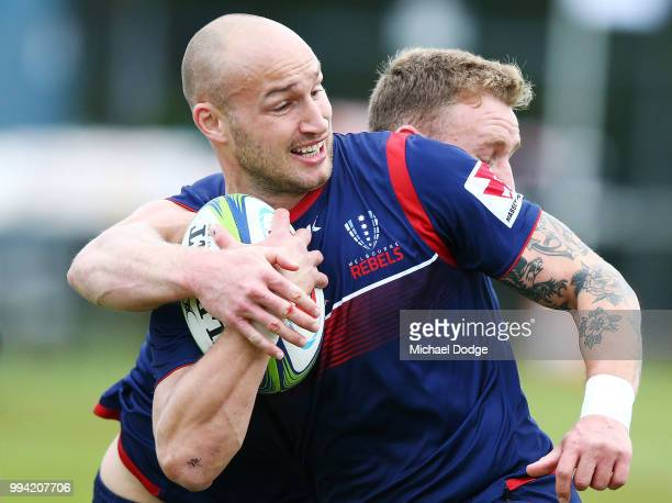Bill Meakes of the Rebels runs with the ball past Reece Hodge during a Melbourne Rebels Super Rugby training session at Gosch's Paddock on July 9...