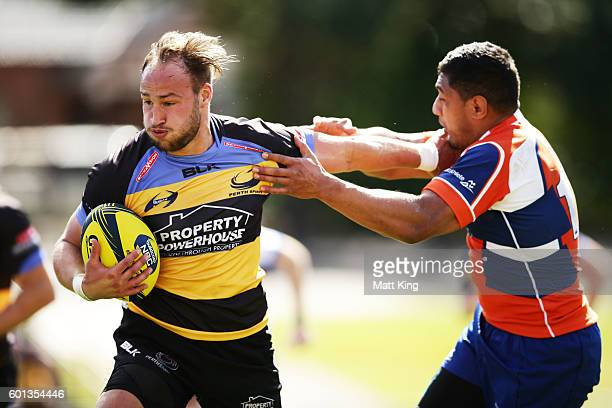 Bill Meakes of the Spirit puts a fend on during the round three NRC match between the Western Sydney Rams and the Perth Spirit at Concord Oval on...