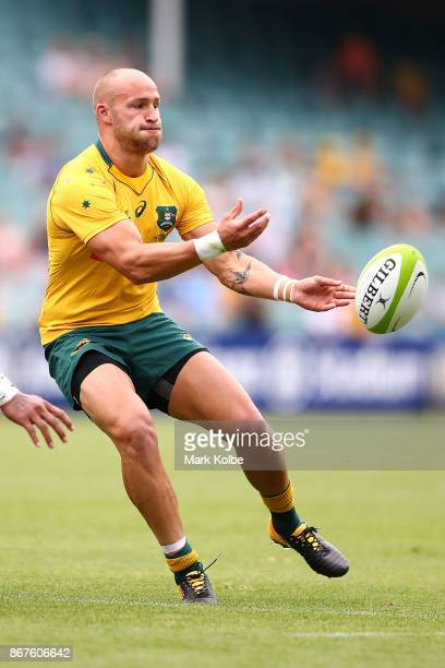 Bill Meakes of the Wallabies passes during the match between the Australian Wallabies and the Barbarians at Allianz Stadium on October 28 2017 in...