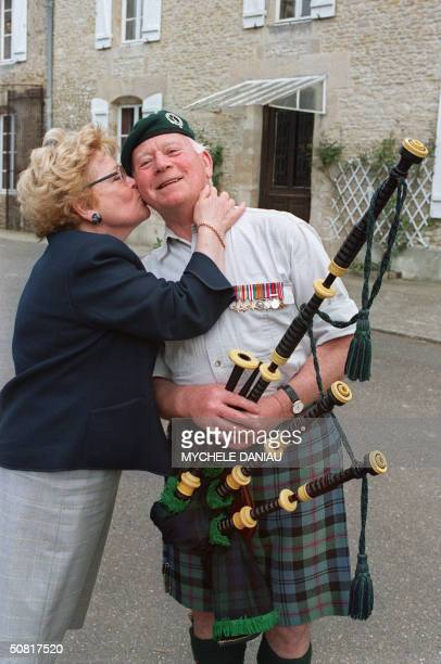 Bill Millin a Scottish piper who landed with British Troops on DDay is reunited 25 April 1995 with Josette Gouellain in Ranville Normandy The two met...