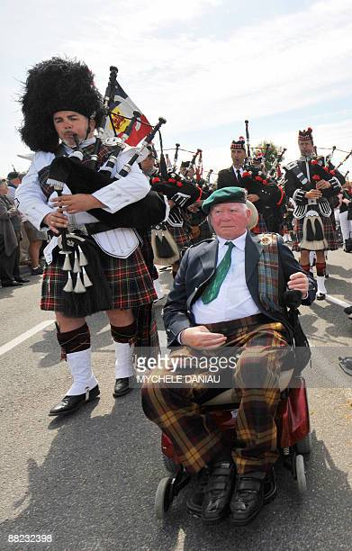 Bill Millin the legendary piper of Pegasus Bridge attends a ceremony with British veterans of the Royal Navy on June 5 2009 in CollevilleMontgommery...