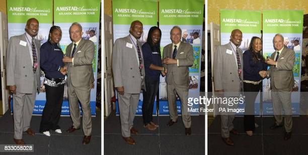 Bill Minter left with Clay Maitland of Amistad America present a watch to Saphra Ross Nadia Waithe and Chantelle Wright all of Bristol at the launch...