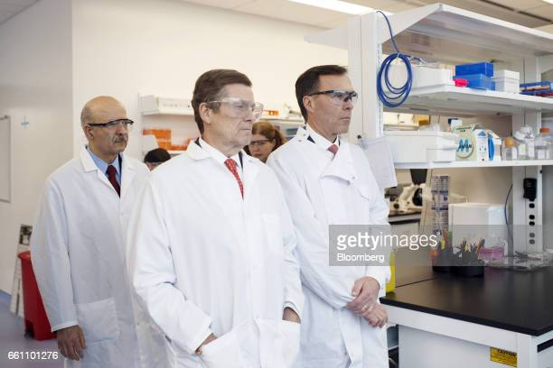 Bill Morneau Canada's finance minister from right John Tory mayor of Toronto and Reza Moridi minister of research and innovation of Ontario observe...
