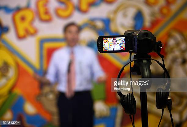 Bill Morneau Canada's finance minister is seen on the screen of a video camera while speaking during a press conference at the Central Neighbourhood...