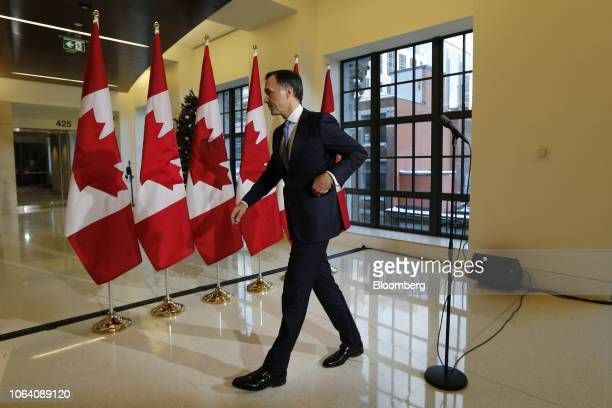 Bill Morneau Canada's finance minister leaves after speaking during a press conference before tabling the Fall Economic Statement in Ottawa Ontario...