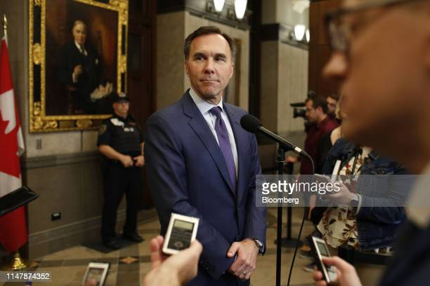 Bill Morneau Canada's finance minister listens to a question from a member of the media during a news conference at the House of Commons in Ottawa...