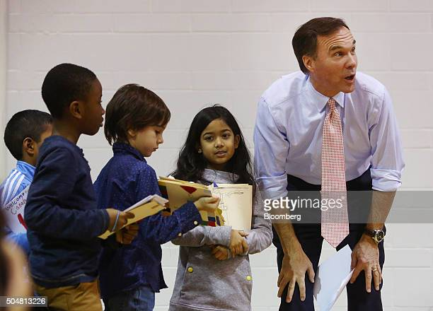 Bill Morneau Canada's finance minister right helps children from Sprucecourt Public School give their welcome to Canada cards to newly landed Syrian...