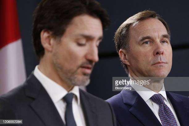 Bill Morneau Canada's finance minister right listens while Justin Trudeau Canada's prime minister speaks during a news conference on the coronavirus...