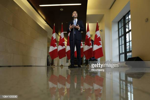 Bill Morneau Canada's finance minister speaks during a press conference before tabling the Fall Economic Statement in Ottawa Ontario Canada on...
