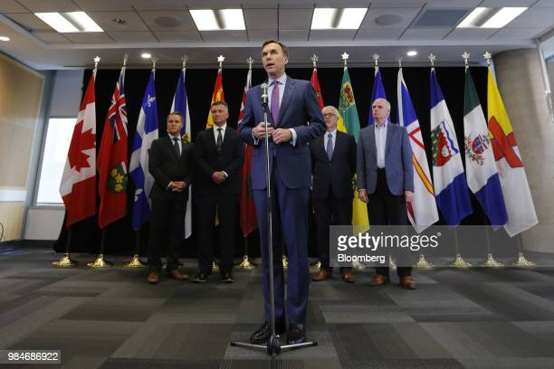 Bill Morneau Canada's minister of finance center speaks during a press conference following a meeting with provincial and territorial finance...