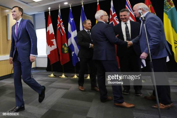 Bill Morneau Canada's minister of finance left leaves after a press conference following a meeting with provincial and territorial finance ministers...