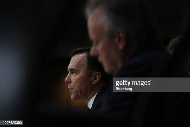 Bill Morneau Canada's minister of finance left speaks while Stephen Poloz governor of the Bank of Canada listens during a news conference in Ottawa...