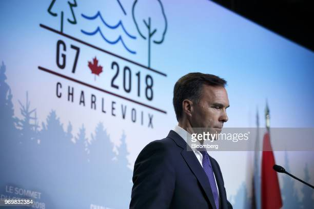Bill Morneau Canada's minister of finance listens at a press conference during the Group of Seven Leaders Summit in La Malbaie Quebec Canada on...