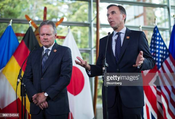 Bill Morneau Canada's minister of finance right speaks as Stephen Poloz governor of the Bank of Canada listens during a news conference at the...