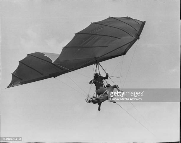 Bill Moyes with Helen Vause on his back flies over Botany Bay near Ramsgate in preparation for a jump off Mt Fuji in Japan soon May 26 1972