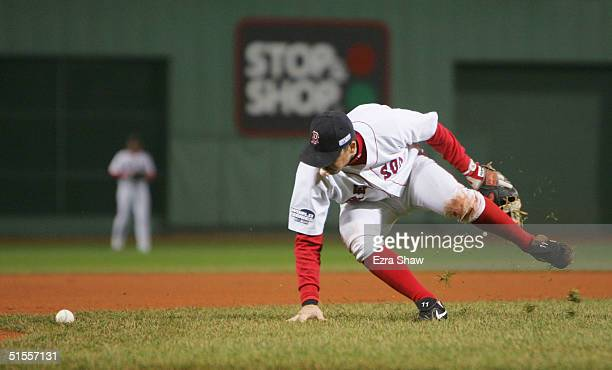 Bill Mueller of the Boston Red Sox bobbles ball hit by Reggie Sanders of the St Louis Cardinals scores Albert Pujols during the fourth inning of game...