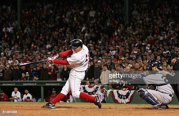 Bill Mueller of the Boston Red Sox hits a gametying RBI single in the ninth inning against the New York Yankees during game four of the American...