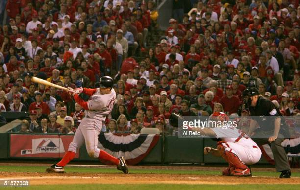 Bill Mueller of the Boston Red Sox hits a RBI single against the St Louis Cardinals during the fifth inning of game three of the World Series on...