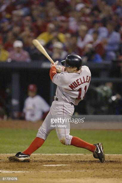 Bill Mueller of the Boston Red Sox hits an RBI single in the fifth inning during game three of the 2004 World Series against the St. Louis Cardinals...