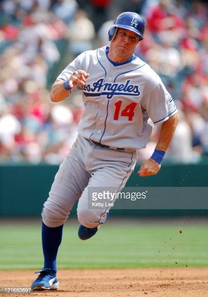 Bill Mueller of the Los Angeles Dodgers sprints toward third base during 42 loss to the Los Angeles Angels of Anaheim in Interleague Exhibition...